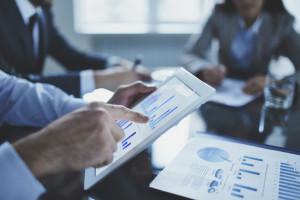 professionals discussing market data