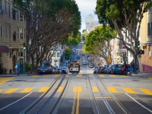 street view of trolley rails going down san francisco streets.